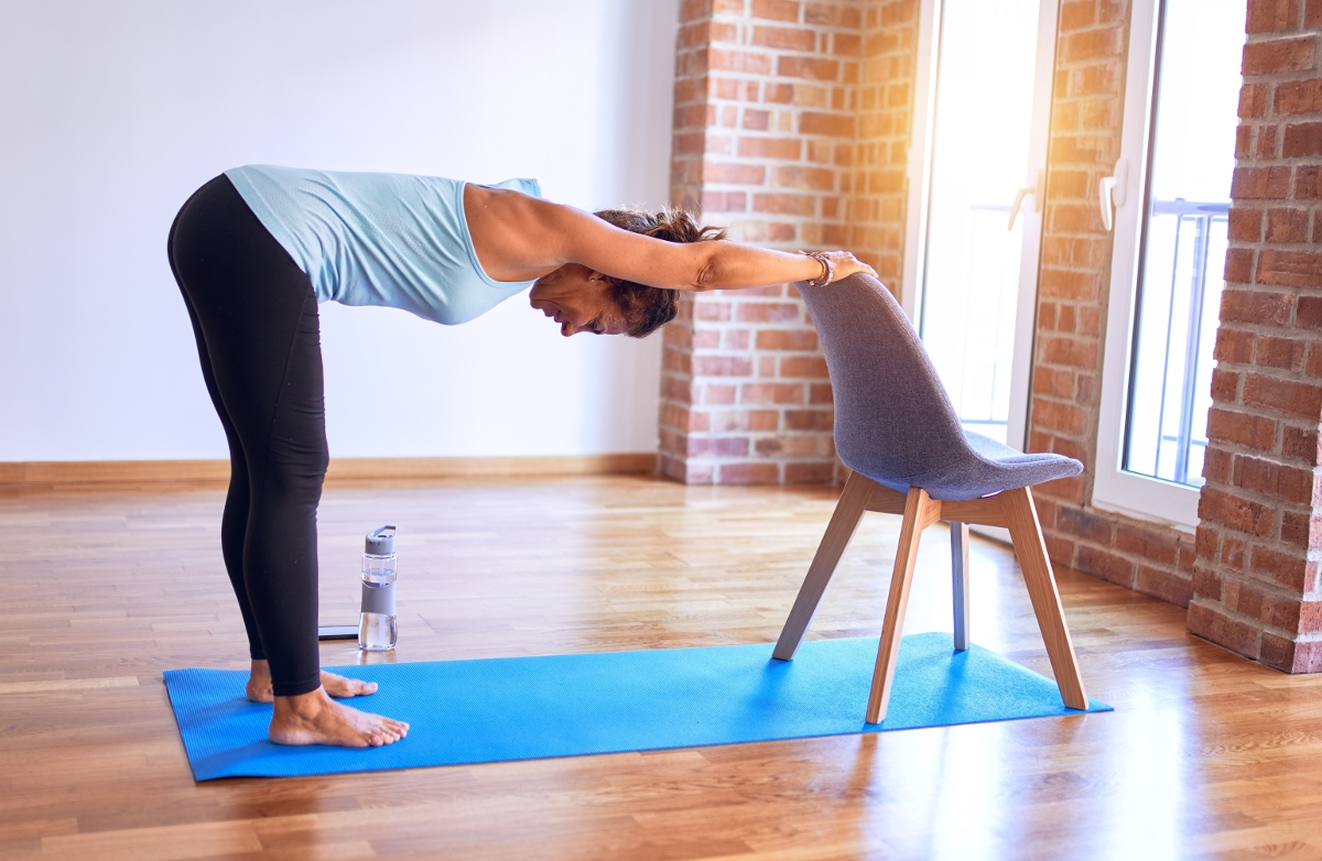 8 Yoga Poses You Can Do Right Now In Your Chair